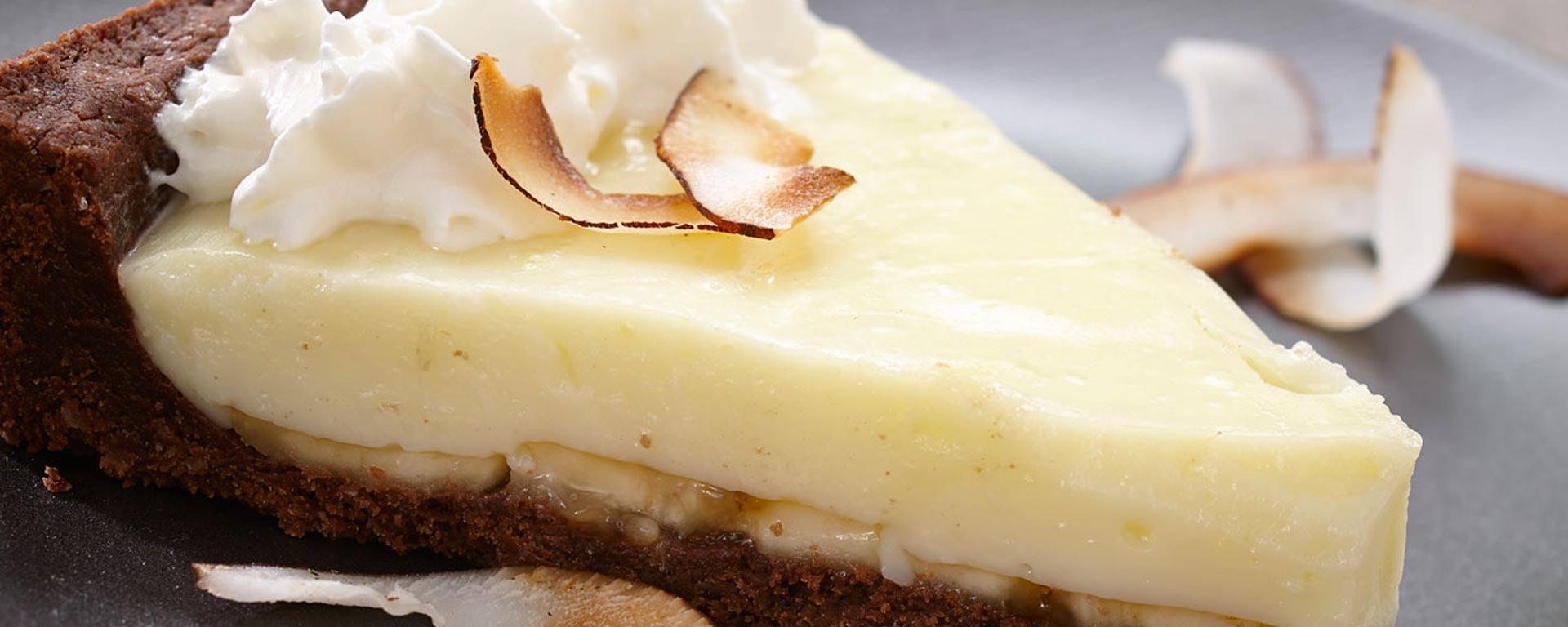 Photo for - Tarte à la crème suprême au chocolat, à la noix de coco et aux bananes